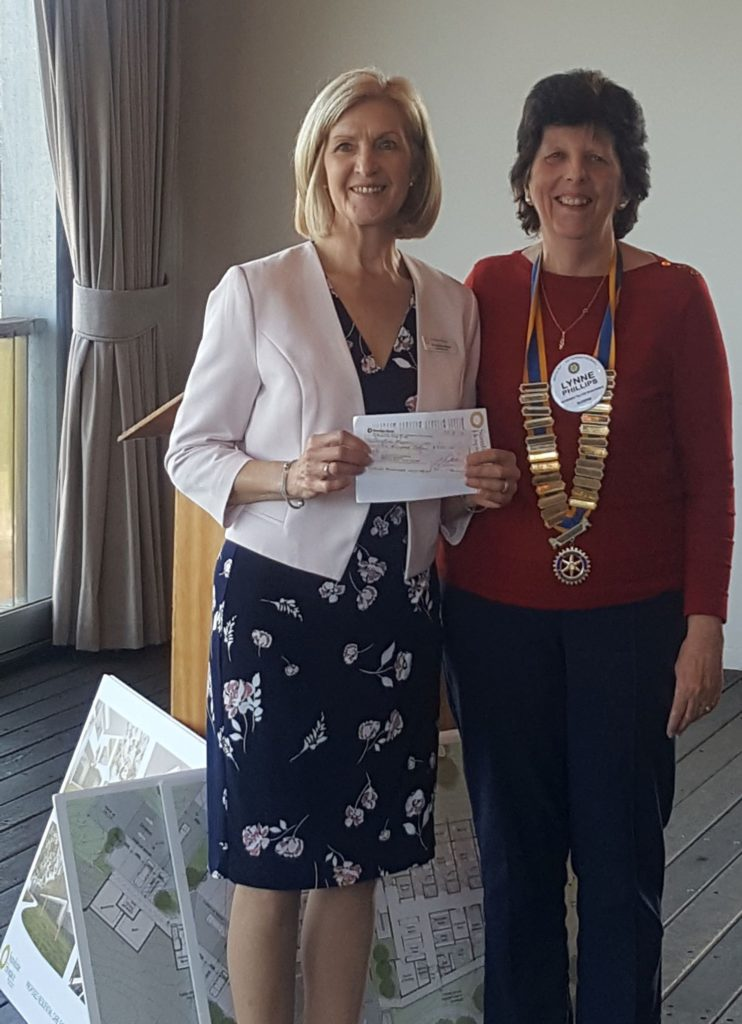 President Lynne presents a donation to Sue Mason-Baker from Sunshine Hospice
